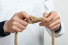 A sailor tie a sea knot Royalty Free Stock Images