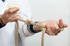 A sailor tie a sea knot Royalty Free Stock Photo