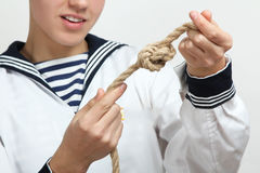 Sailor tying a sea knot Royalty Free Stock Images
