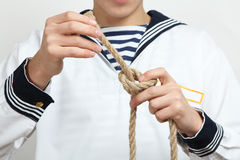 Sailor tying a sea knot Stock Images