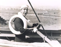 Sailor wearing two life preservers Stock Photography