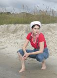 Sailor woman on the beach Royalty Free Stock Photography