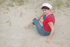 Sailor woman on the beach Royalty Free Stock Images