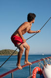 Sailor on work. Sailor holding the rope of front sail stock photos