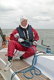 Sailor at work during sailing race Stock Image