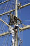 Sailor working in the rigging of a sailboat Stock Images