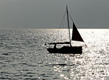 The sailorman's shadow at the sunset Stock Images
