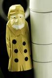 Sailorman Standing. A sailor figurine standing next to a column Stock Photo