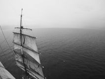 Sailors aloft in the open ocean Stock Images