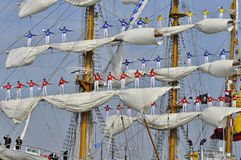 The sailors of the ARC Gloria. Port Amsterdam, Amsterdam, the Netherlands - August 23, 2015: Sailors of the ARC Gloria tall ship (Colombia) standing on the masts Royalty Free Stock Photography