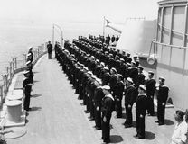 Sailors at attention on naval ship Stock Images