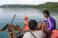 Sailors on the boat that reaches Koh Rong Sanloem island Royalty Free Stock Image