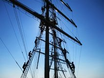Sailors climb the mast stock photography