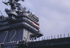 Sailors on Deck of Aircraft Carrier Stock Image