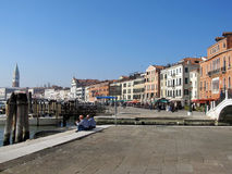 Sailors on lunch break in Venice. This image presents a beautiful view of the Venice, Italy, with two sailors having their lunch break Royalty Free Stock Image