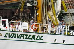 Sailors make photos on the deck of a sailboat. royalty free stock photos