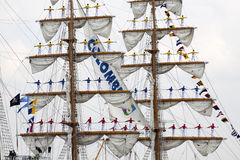 Sailors on the mast during sail 2015. Port of Amsterdam, Noord-Holland/ ,Netherlands - August 19 ,2015 : Sailors on the masts of the tall ship Arc Gloria from Royalty Free Stock Photos