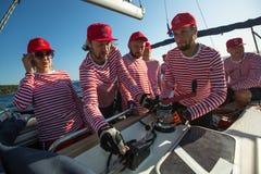 Sailors participate in sailing regatta 20th Ellada Autumn 2018 among Greek island group in the Aegean Sea royalty free stock image
