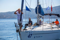 Sailors participate in sailing regatta. POROS, GREECE - SEP 29, 2016: Sailors participate in sailing regatta 16th Ellada Autumn 2016 among Greek island group in Royalty Free Stock Images