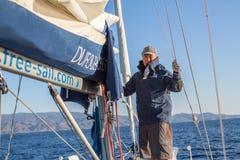Sailors participate in sailing regatta. POROS, GREECE - SEP 29, 2016: Sailors participate in sailing regatta 16th Ellada Autumn 2016 among Greek island group in Stock Images
