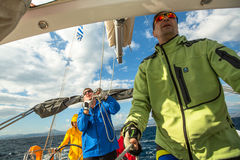 Sailors participate in sailing regatta 12th Ellada Autumn 2014 among Greek island group in the Aegean Sea, Royalty Free Stock Image