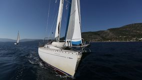 Sailors participate in sailing regatta 16th Ellada Autumn 2016 among Greek island group in the Aegean Sea, in Cyclades stock video