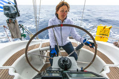 Sailors participate in sailing regatta 12th Ellada Autumn 2014 among Greek island group in the Aegean Sea Stock Images