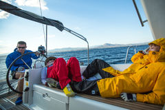 Sailors participate in sailing regatta 12th Ellada Autumn 2014 among Greek island group in the Aegean Sea. HYDRA, GREECE - CIRCA OCT, 2014: Unidentified sailors royalty free stock image