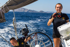 Sailors participate in sailing regatta 16th Ellada Autumn 2016 among Greek island group in the Aegean Sea. HYDRA, GREECE - SEP 28, 2016: Sailors participate in Stock Photos