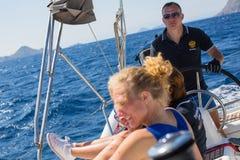 Sailors participate in sailing regatta 16th Ellada Autumn 2016 among Greek island group in the Aegean Sea. HYDRA, GREECE - SEP 28, 2016: Sailors participate in Royalty Free Stock Photography