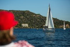 Sailors participate in sailing regatta 20th Ellada Autumn 2018 among Greek island group in the Aegean Sea royalty free stock photography