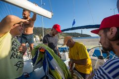 Sailors participate in sailing regatta 20th Ellada Autumn 2018 among Greek island group in the Aegean Sea stock images