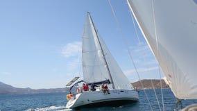 Sailors participate in sailing regatta 16th Ellada Autumn 2016 among Greek island group in the Aegean Sea stock video
