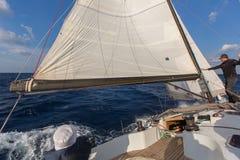 Sailors participate in sailing regatta 16th Ellada Autumn 2016 among Greek island group in the Aegean Sea. MILOS, GREECE - SEP 27, 2016: Sailors participate in Stock Images