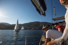 Sailors participate in sailing regatta 16th Ellada Autumn 2016 among Greek island group in the Aegean Sea. POROS, GREECE - SEP 29, 2016: Sailors participate in Stock Photos