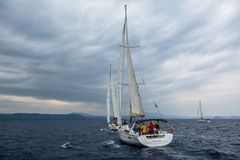 Sailors participate in sailing regatta 12th Ellada Autumn 2014 among Greek island group in the Aegean Sea. PYLOS, GREECE - CIRCA OCT, 2014: Unidentified sailors royalty free stock images