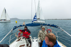 Sailors participate in sailing regatta 12th Ellada Autumn 2014 among Greek island group in the Aegean Sea Royalty Free Stock Photo