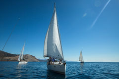 Sailors participate in sailing regatta 12th Ellada Autumn 2014 among Greek island group in the Aegean Sea. TRIZONIA, GREECE - CIRCA OCT, 2014: Unidentified royalty free stock image