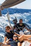 Sailors participate in sailing regatta 16th Ellada Autumn 2016 among Greek island group. HYDRA, GREECE - SEP 28, 2016: Sailors participate in sailing regatta Royalty Free Stock Image