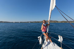 Sailors participate in sailing regatta 16th Ellada Autumn 2016 among Greek island group. HYDRA, GREECE - SEP 28, 2016: Sailors participate in sailing regatta Stock Images