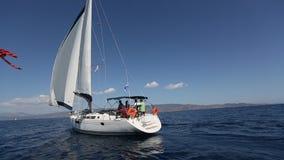 Sailors participate in sailing regatta 16th Ellada Autumn 2016 among Greek island group stock video