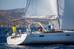 Sailors participate in sailing regatta 16th Ellada Autumn 2016 among Greek island group. POROS, GREECE - SEP 29, 2016: Sailors participate in sailing regatta Royalty Free Stock Photo