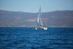 Sailors participate in sailing regatta 16th Ellada. ERMIONI, GREECE - OCT 5, 2016: Sailors participate in sailing regatta 16th Ellada Autumn 2016 among Greek Royalty Free Stock Images