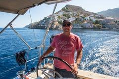 Sailors participate in sailing regatta 16th Ellada. HYDRA, GREECE - OCT 4, 2016: Sailors participate in sailing regatta 16th Ellada Autumn 2016 among Greek Stock Photo