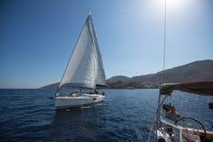Sailors participate in sailing regatta 16th Ellada. HYDRA, GREECE - OCT 4, 2016: Sailors participate in sailing regatta 16th Ellada Autumn 2016 among Greek Royalty Free Stock Images