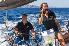 Sailors participate in sailing regatta 16th Ellada. HYDRA, GREECE - SEP 28, 2016: Sailors participate in sailing regatta 16th Ellada Autumn 2016 among Greek Stock Photo