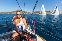 Sailors participate in sailing regatta 16th Ellada. HYDRA, GREECE - SEP 28, 2016: Sailors participate in sailing regatta 16th Ellada Autumn 2016 among Greek Stock Images