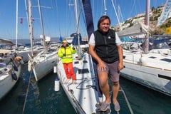 Sailors participate in sailing regatta 16th Ellada. HYDRA, GREECE - SEP 28, 2016: Sailors participate in sailing regatta 16th Ellada Autumn 2016 among Greek Royalty Free Stock Photography