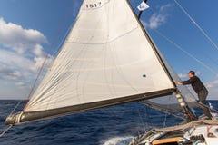 Sailors participate in sailing regatta 16th Ellada. MILOS, GREECE - SEP 27, 2016: Sailors participate in sailing regatta 16th Ellada Autumn 2016 among Greek Royalty Free Stock Photo