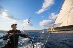 Sailors participate in sailing regatta 16th Ellada. MILOS, GREECE - SEP 27, 2016: Sailors participate in sailing regatta 16th Ellada Autumn 2016 among Greek Stock Images
